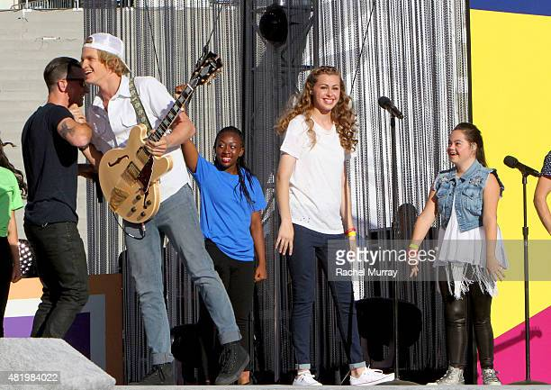 Marc Roberge of OAR Cody Simpson Bree Bogucki and Madison Tevlin open the 2015 Los Angeles Special Olympics World Games by performing the CocaCola...