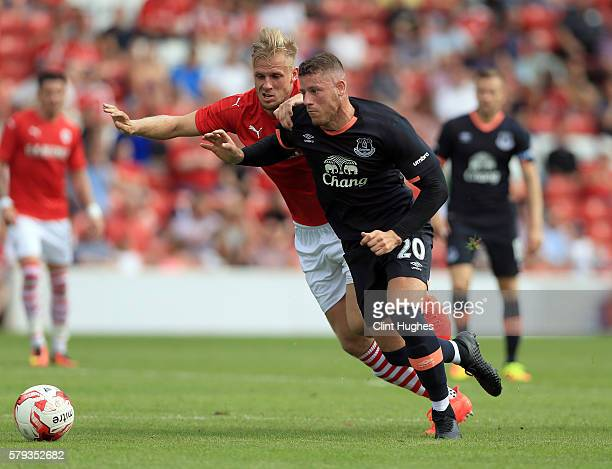 Marc Roberts of Barnsley and Ross Barkley of Everton battle for the ball during the preseason friendly match between Barnsley and Everton at Oakwell...
