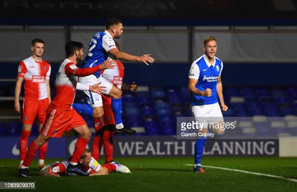Marc Roberts of Birmingham City celebrates with his team mates after scoring his sides first goal during the Sky Bet Championship match between...