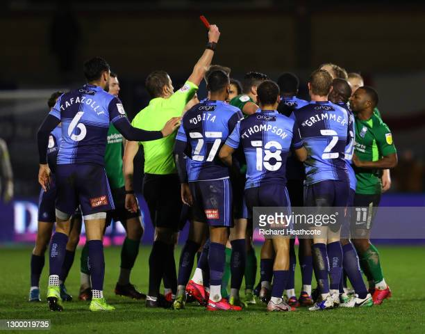Marc Roberts of Birmingham City is shown a red card by Referee, John Brooks during the Sky Bet Championship match between Wycombe Wanderers and...