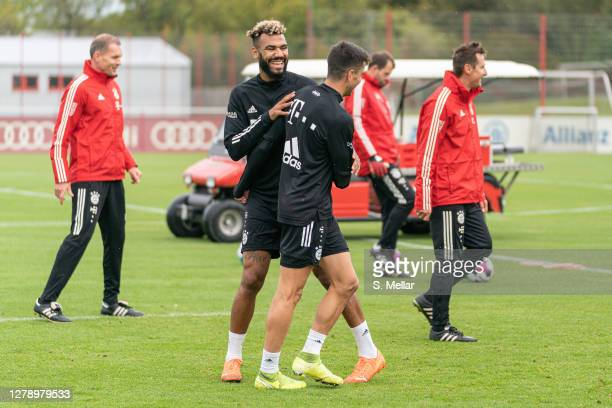 Marc Roca and Eric Maxim Choupo-Moting of Bayern Munich laugh during a training session at Saebener Strasse training ground on October 07, 2020 in...