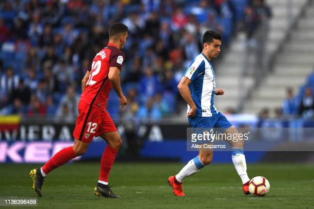 Marc Roca of Espanyol and Andre Silva of Sevilla in action during the La Liga match between RCD Espanyol and Sevilla FC at RCDE Stadium on March 17...