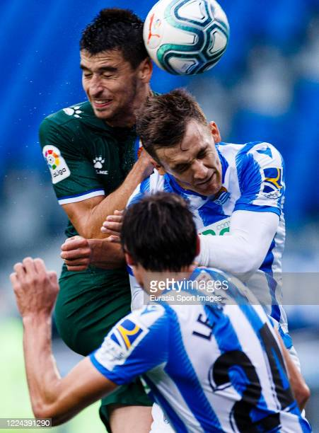 Marc Roca of Espanyol battles for the ball with Diego Llorente Ríos of Real Sociedad during the Liga match between Real Sociedad and RCD Espanyol at...