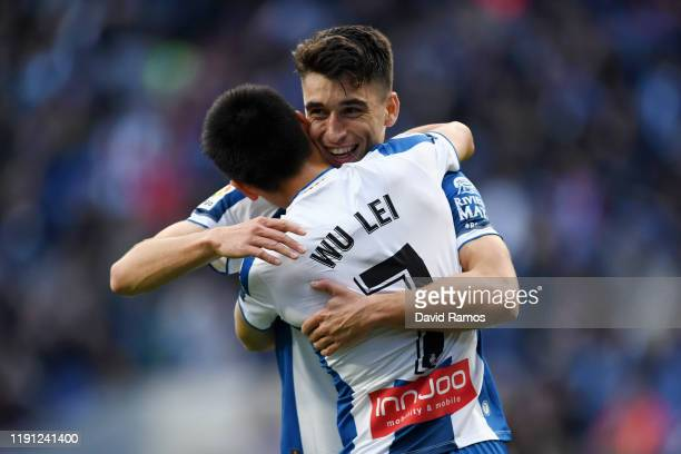 Marc Roca of Espanyol celebrates with team mate Wu Lei after he scores from the penalty spot during the La Liga match between RCD Espanyol and CA...