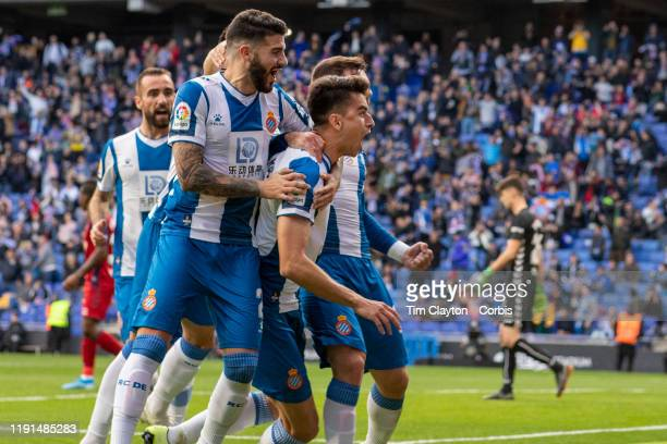 Marc Roca of Espanyol celebrates with Victor Campuzano of Espanyol Pipa of Espanyol and team mates after scoring from the penalty spot during the...