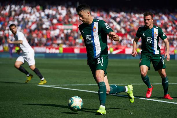 Marc Roca of Espanyol runs with the ball during the Liga match between Sevilla FC and RCD Espanyol at Estadio Ramon Sanchez Pizjuan on February 16...