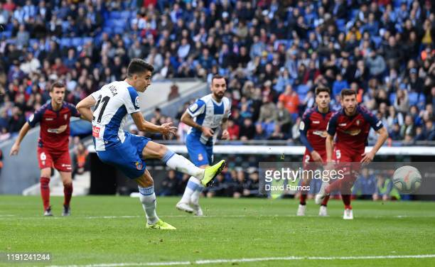 Marc Roca of Espanyol scores from the penalty spot during the La Liga match between RCD Espanyol and CA Osasuna at RCDE Stadium on December 01 2019...