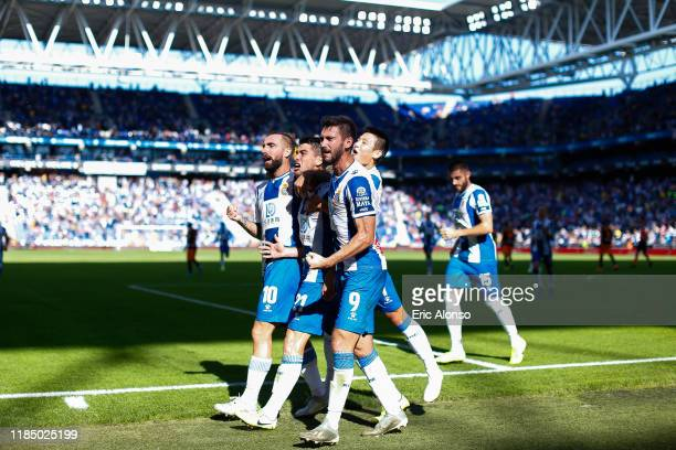 Marc Roca of RCD Espanyol celebrates with team mates as they lead 10 from the penalty spot during the Liga match between RCD Espanyol and Valencia CF...