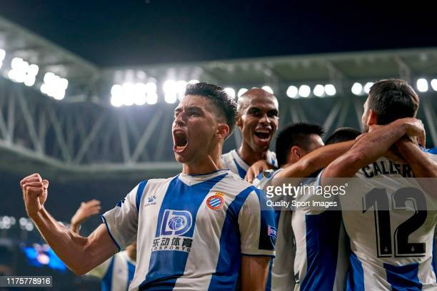 Marc Roca of RCD Espanyol celebrates with teammates their team's first goal scored by Matias Vargas during the UEFA Europa League group H match...
