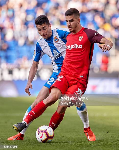 Marc Roca of RCD Espanyol competes for the ball against Andre Silva of Sevilla FC during the La Liga match between RCD Espanyol and Sevilla FC at...