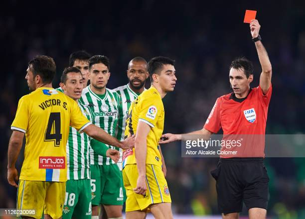 Marc Roca of RCD Espanyol is shown a red card by referee Ricardo De Burgos Bengoetxea during the Copa del Quarter Final match between Real Betis...