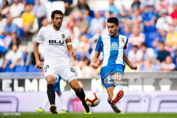 Marc Roca of RCD Espanyol plays the ball next to Daniel Parejo of Valencia CF during the La Liga match between RCD Espanyol and Valencia CF at RCDE...