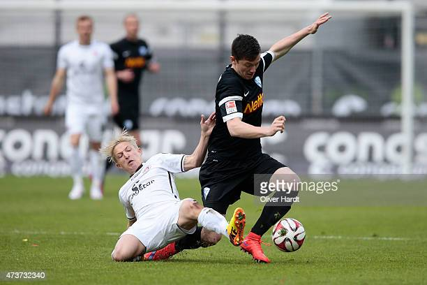 Marc Rzatkowski of St Pauli and Michael Gregoritsch of Bochum compete for the ball during the Second Bundesliga match between FC St Pauli and VfL...
