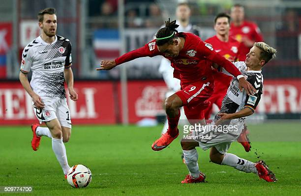 Marc Rzatkowski of St Pauli challenges for the ball with Yussuf Poulsen of Leipzig during the second Bundesliga match between FC St Pauli and RB...