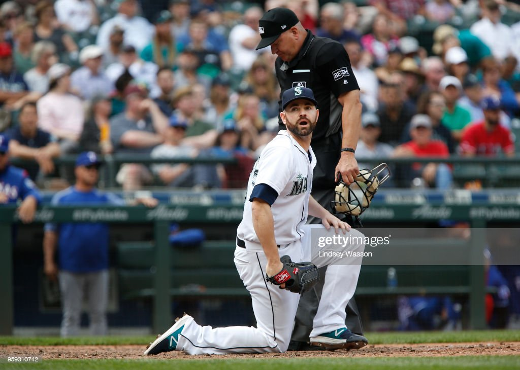 Marc Rzepczynski #25 of the Seattle Mariners reacts after the umpire calls Isiah Kiner-Falefa #9 of the Texas Rangers safe at home in the ninth inning at Safeco Field on May 16, 2018 in Seattle, Washington.