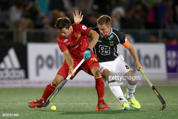 Marc Salles of Spain and Mats Grambusch of Germany battle for possession during the semifinal match between Spain and Germany on Day 7 of the FIH...