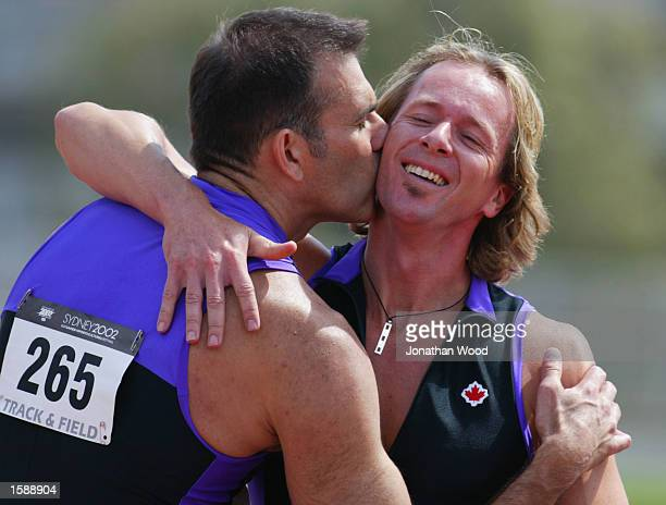 Marc Samson of Vancouver USA is congratulated by Allan Cline after winning silver in the Men's 35 years 400 metre hurdles during the 2002 Sydney Gay...