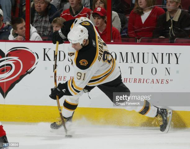 Marc Savard of the Boston Bruins fires a slap shot during their NHL game against the Carolina Hurricanes on December 28, 2007 at RBC Center in...