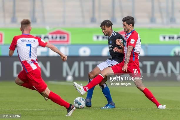 Marc Schnatterer of 1.FC Heidenheim 1846, Josha Vagnoman of Hamburger SV and Tim Kleindienst of 1.FC Heidenheim 1846 battle for the ball during the...