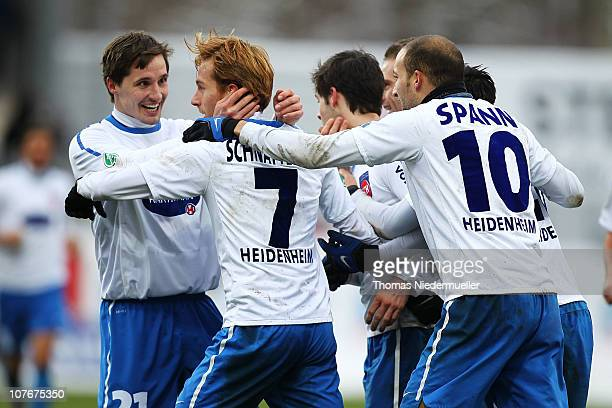 Marc Schnatterer of Heidenheim celebrates after scoring his team's goal with his team mates during the Third League match between 1.FC Heidenheim and...