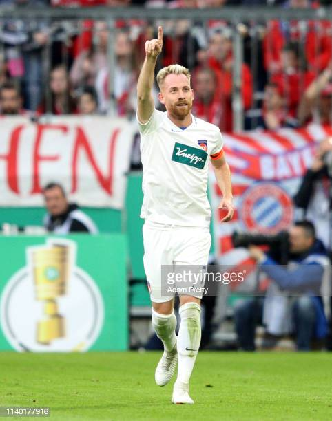 Marc Schnatterer of Heidenheim celebrates his team's second goal during the DFB Cup quarterfinal match between Bayern Muenchen and 1 FC Heidenheim at...