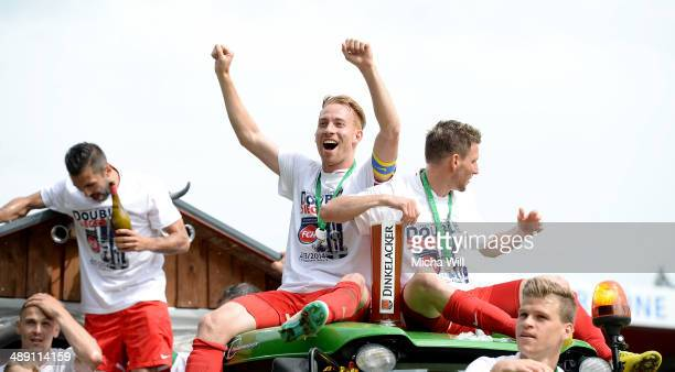Marc Schnatterer of Heidenheim celebrates the championship title win of the Third League at Voith-Arena on May 10, 2014 in Heidenheim, Germany.