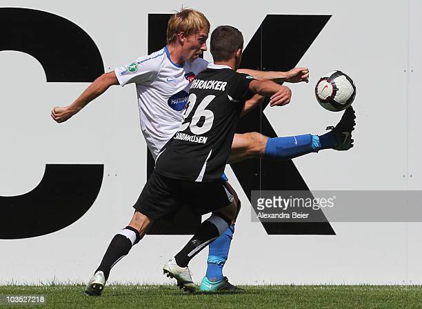 Marc Schnatterer of Heidenheim fights for the ball with Dominik Rohracker of Sandhausen during a Third League match between 1.FC Heidenheim and SV...