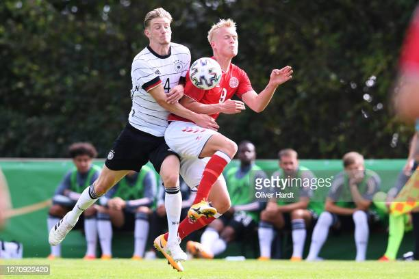 Marc Schroeder of Germany competes for the ball with Tobias Bech of Denmark during the international friendly match between Germany U20 and Denmark...