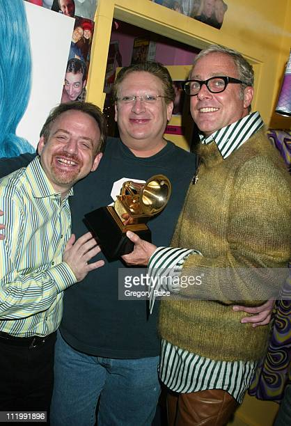 Marc Shaiman Harvey Fierstein and Scott Wittman pose with the Grammy they won for Best Show Album backstage after the show