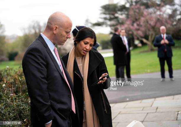 Marc Short Chief of Staff for Vice President Mike Pence talks with Katie Miller Vice President Mike Pence's press secretary as President Donald Trump...