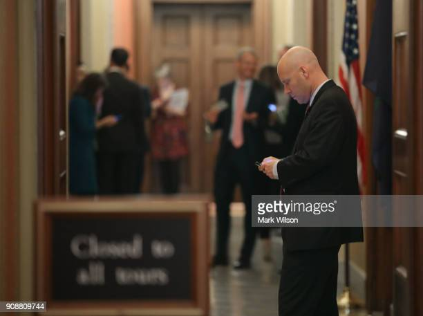 Marc Short Director of Legislative Affairs for the White House stands outside of a closed door Senate Republican meeting at the US Capitol on January...