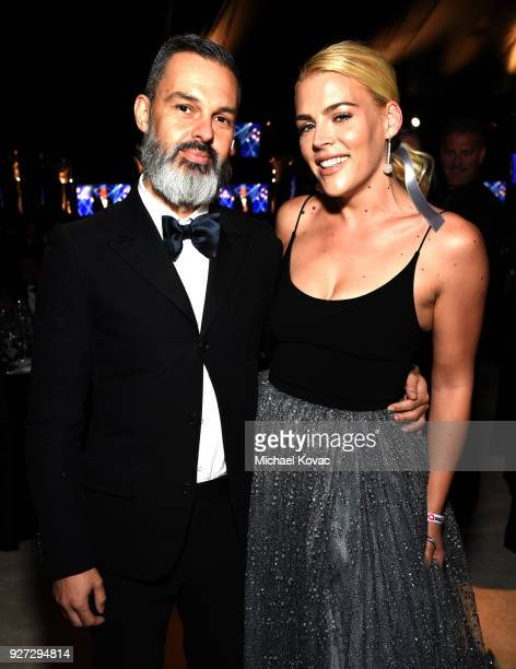 Marc Silverstein and Busy Philipps attend the 26th annual Elton John AIDS Foundation Academy Awards Viewing Party sponsored by Bulgari celebrating...