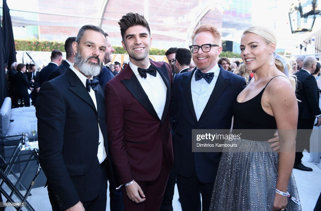 Marc Silverstein, Justin Mikita, Jesse Tyler Ferguson, and Busy Philipps attend the 26th annual Elton John AIDS Foundation Academy Awards Viewing Party sponsored by Bulgari, celebrating EJAF and the 90th Academy Awards at The City of West Hollywood Park on March 4, 2018 in West Hollywood, California.