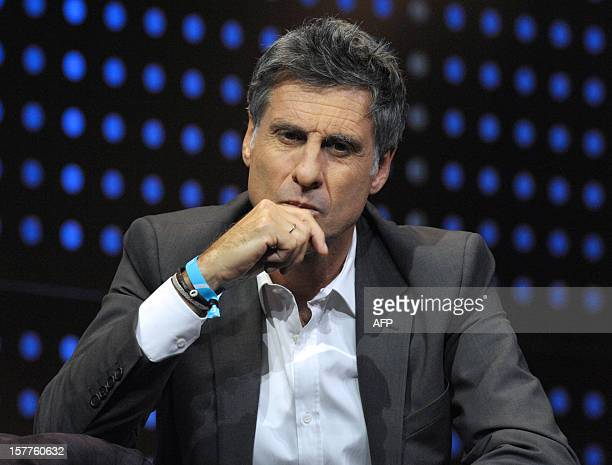 Marc Simoncini Founder and CEO of Meetic and Jaina Capital listens while taking part in a jury for a StartUp Competition during LeWeb conference in...