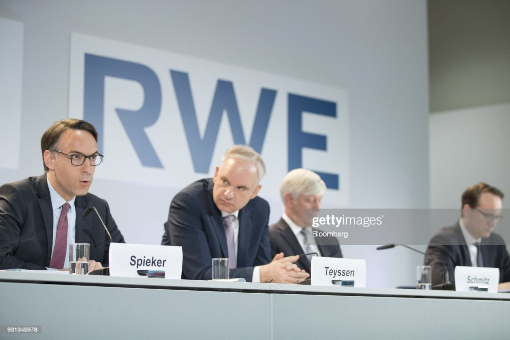Marc Spieker, chief financial officer of EON SE, left, speaks as he sits beside Johannes Teyssen, chief executive officer of EON SE, Rolf Schmitz, chief executive officer of RWE AG, and Markus Krebber, chief financial officer of RWE AG, during a news conference in Essen, Germany, on Tuesday, March 13, 2018. EON will shed as many as 5,000 jobs in the deal to take over Innogy SE, a move that marks the biggest shakeup in Germany's energy business in years. Photographer: Jasper Juinen/Bloomberg via Getty Images