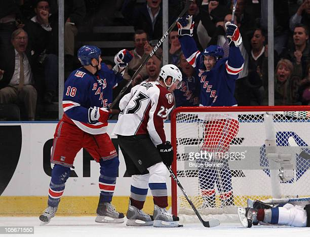 Marc Staal and Alex Frolov of the New York Rangers celebrate Frolov's first goal of the season at 1809 of the first period against the Colorado...