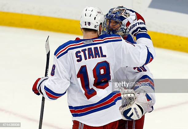 Marc Staal and Henrik Lundqvist of the New York Rangers celebrate defeating the Tampa Bay Lightning 5 to 1 in Game Four of the Eastern Conference...