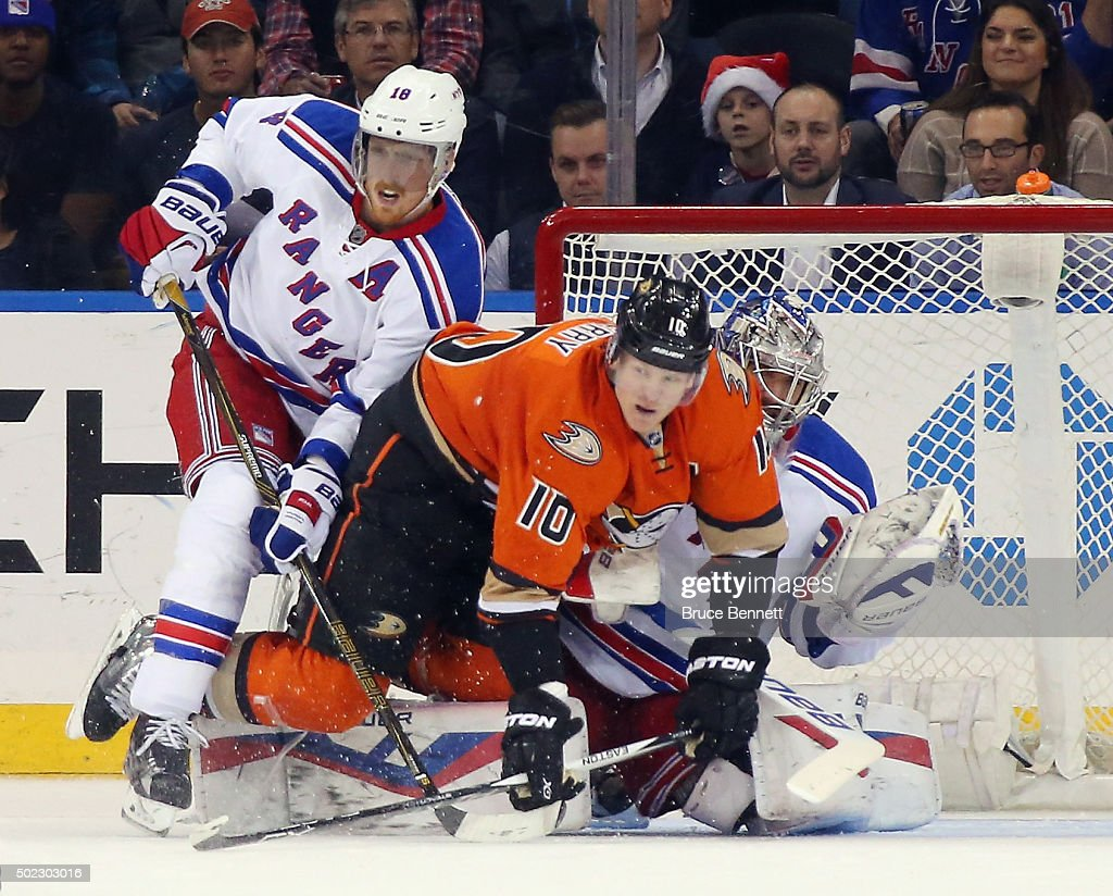 Marc Staal #18 and Henrik Lundqvist #30 of the New York Rangers defend against Corey Perry #10 of the Anaheim Ducks during the second period at Madison Square Garden on December 22, 2015 in New York City.