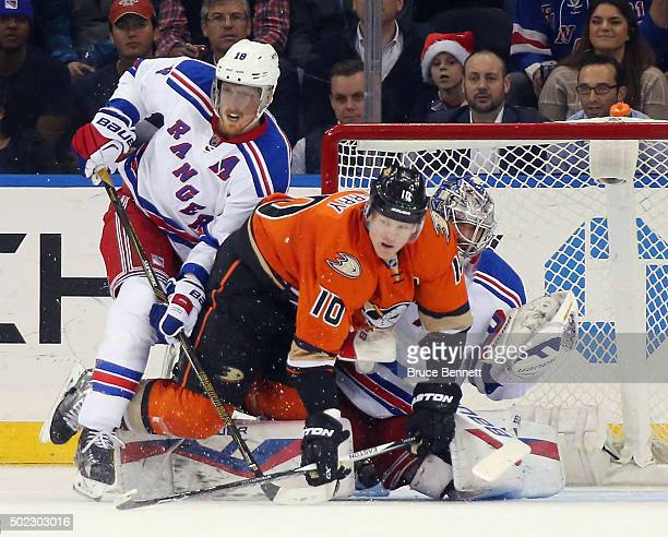Marc Staal and Henrik Lundqvist of the New York Rangers defend against Corey Perry of the Anaheim Ducks during the second period at Madison Square...