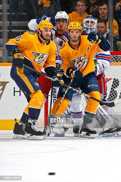 Marc Staal and teammate Henrik Lundqvist of the New York Rangers watch the puck move past Zac Rinaldo and Ryan Hartman of the Nashville Predators...