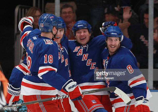 Marc Staal Michael Sauer Ruslan Fedotenko and Brandon Prust of the New York rangers celebrate Fedotenko's first period goal against the Buffalo...