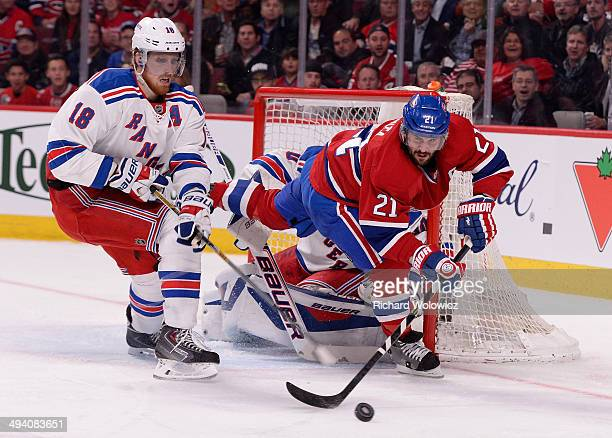 Marc Staal of the New York Rangers and Brian Gionta of the Montreal Canadiens battle for the puck in front of the net during Game Five of the Eastern...