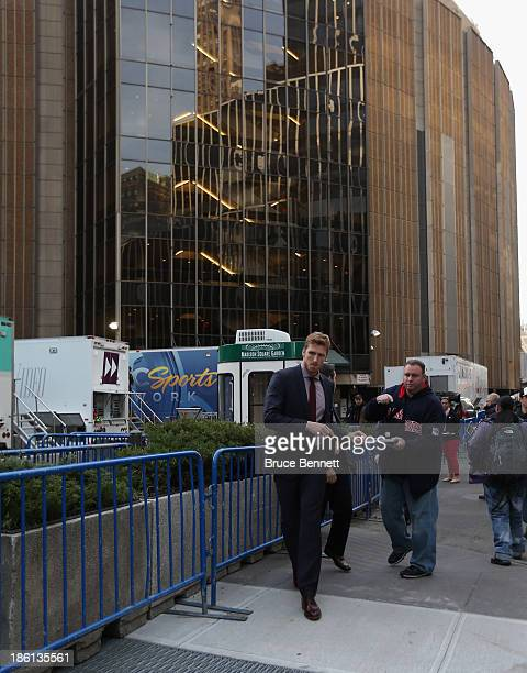 Marc Staal of the New York Rangers arrives for the season home opening game against the Montreal Canadiens at Madison Square Garden on October 28,...