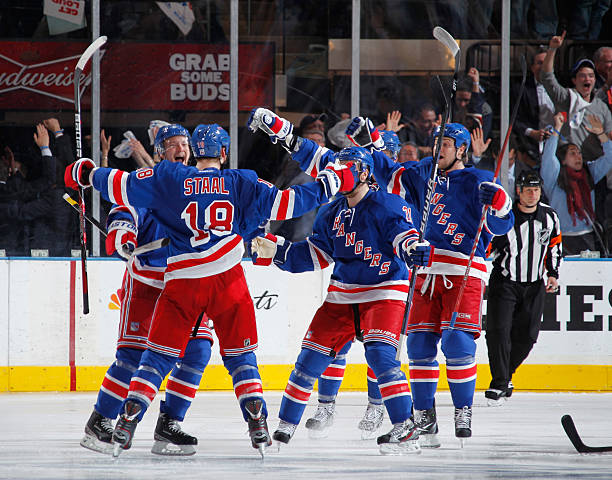 2846dd8ec5b Marc Staal  18 of the New York Rangers celebrates his overtime game-winning  goal