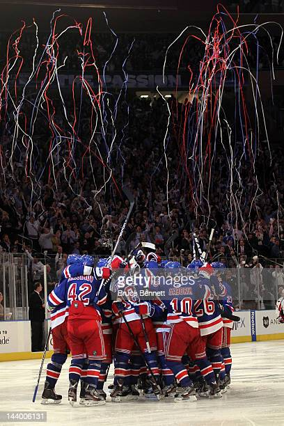 Marc Staal of the New York Rangers celebrates with his teammates after scoring the winning goal in overtime against Braden Holtby of the Washington...