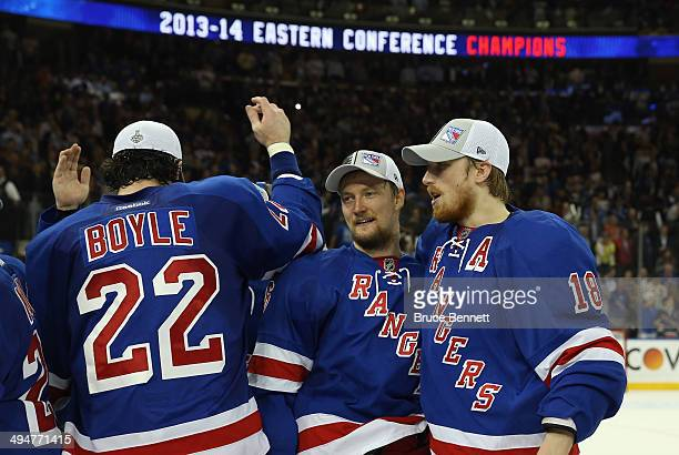 Marc Staal of the New York Rangers celebrateswith teammate Anton Stralman after defeating the Montreal Canadiens in Game Six to win the Eastern...