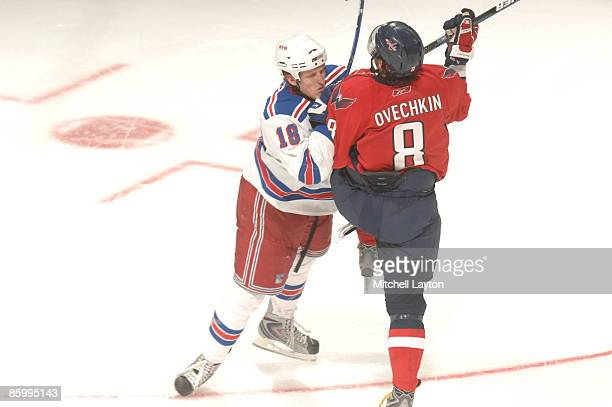 Marc Staal of the New York Rangers checks Alex Ovechkin of the Washington Capitals during Game One of the Eastern Conference Quarterfinals of the...