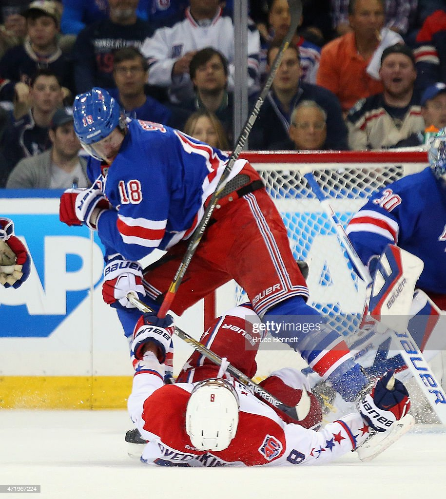 Marc Staal #18 of the New York Rangers checks Alex Ovechkin #8 of the Washington Capitals during the second period in Game Two of the Eastern Conference Semifinals during the 2015 NHL Stanley Cup Playoffs at Madison Square Garden on May 2, 2015 in New York City.