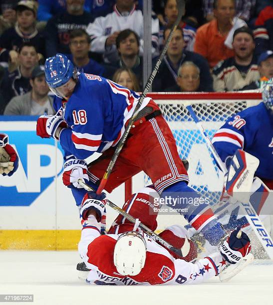 Marc Staal of the New York Rangers checks Alex Ovechkin of the Washington Capitals during the second period in Game Two of the Eastern Conference...
