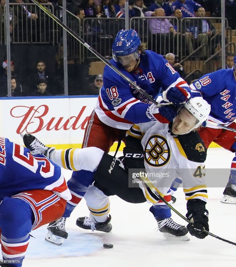 Marc Staal #18 of the New York Rangers checks Danton Heinen #43 of the Boston Bruins during the second period at Madison Square Garden on November 8, 2017 in New York City. The Rangers defeated the Bruins 4-2.